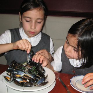 Amber and Amy demolishing mussels at Two Brothers in Finchely