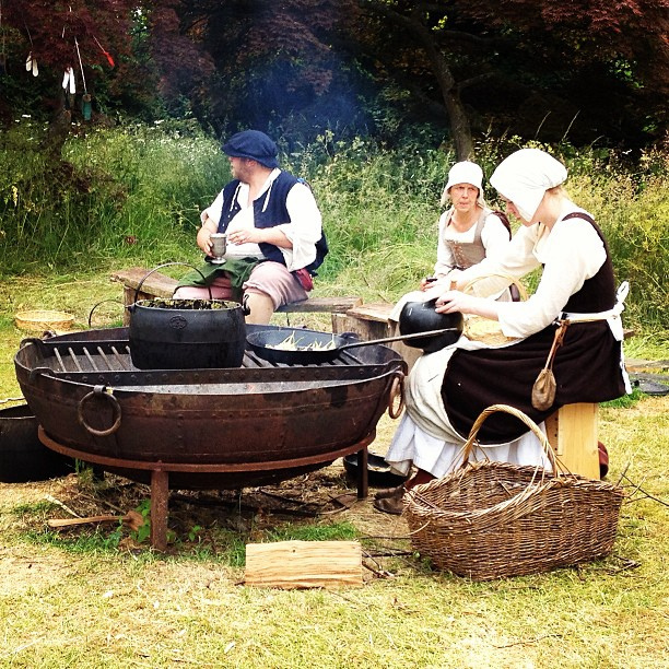 Tudor folk making elderflower fritters at @kentwellhall