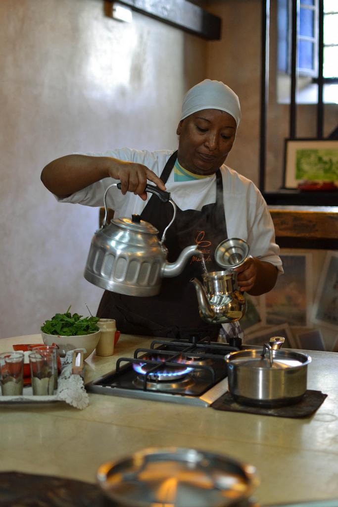 Muna shows the art of mint tea making at L'atelier madada, essaouira